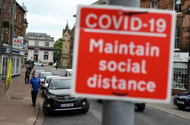 Mask wearing and social distancing measures will end as part of the lifting of lockdown measures in England on 19 July, reports have suggested (Photo: OLI SCARFF/AFP via Getty Images)