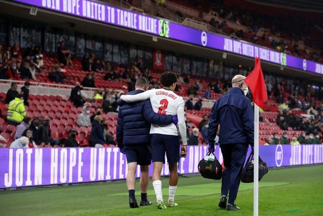 England defender Trent Alexander-Arnold is helped from the pitch in the latter stages of the win over Austria.