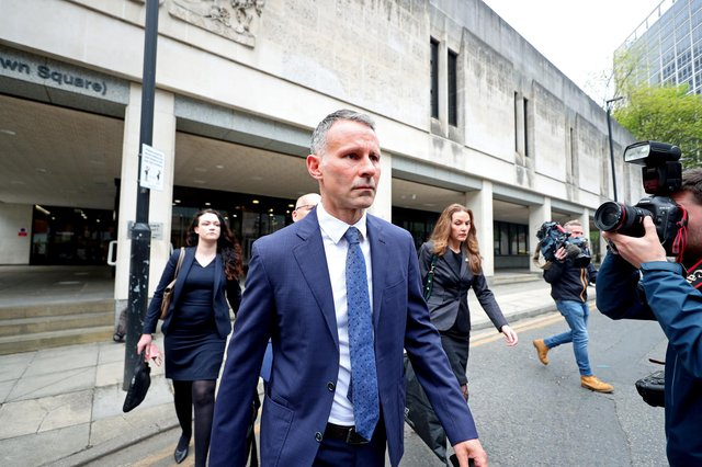Former Manchester United footballer Ryan Giggs leaves Manchester Crown Court on Friday (Photo: PA)