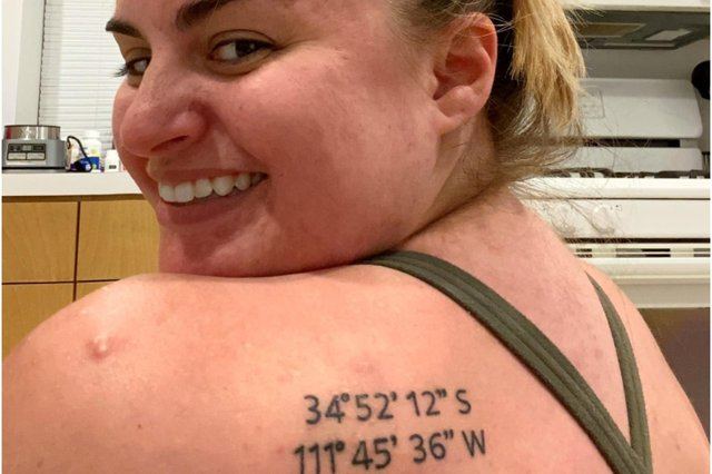A holidaymaker who decided to get a tattoo to mark her favourite beach spot accidentally got the wrong coordinates (Photo: SWNS)