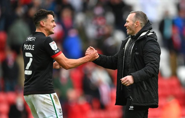 Lincoln City manager Michael Appleton congratulates Regan Poole after reaching the final of the League One play-offs.
