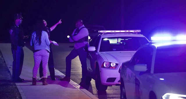 A woman speaks to law enforcement near the FedEx hub following a shooting in Indianapolis (Photo: Mykal McEldowney/The Indianapolis Star via AP)
