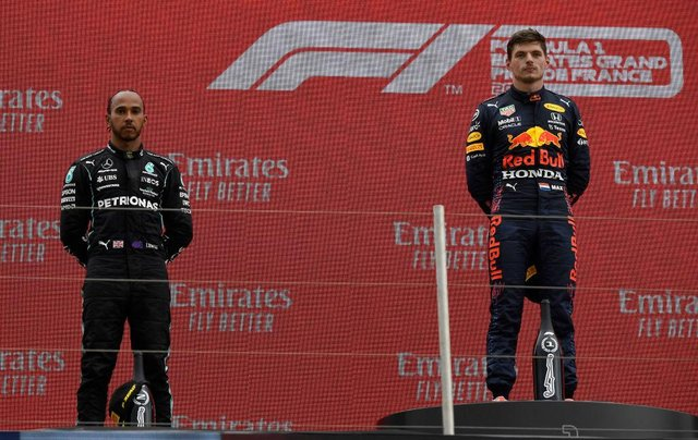 Max Verstappen and Lewis Hamilton. (Photo by Nicolas Tucat - Pool/Getty Images)