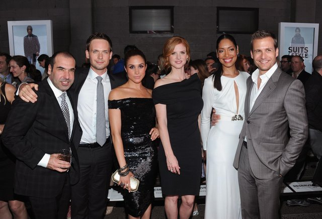 Cast of Suits (L-R) Rick Hoffman, Patrick J. Adams, Meghan Markle, Sarah Rafferty, Gina Torres and Gabriel Macht. (Pic: Getty Images)