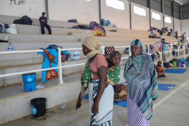 Displaced women from Palma are seen at the Pemba Sports center on April 2 where people were evacuated from the coasts of Palma after armed insurgents attacked the city on March 24. (Getty Images)