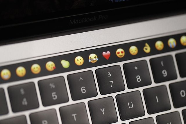 Classic emojis, including the crying laughing face, are declining in popularity according to a recent survey (Getty Images)