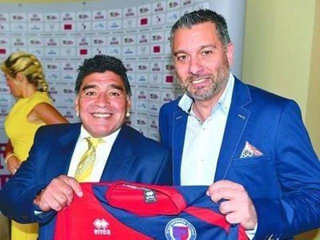 Superstar Diego Maradona poses with a Biggleswade United shirt alongside club chairman Guillem Balague.