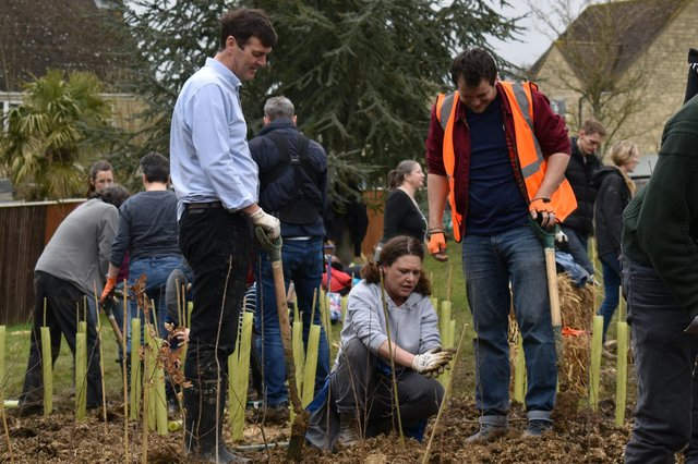 Councillor Duncan Enright helping to plant trees on planting day, March 2020. Witney is home to the UK's first ever tiny forest.