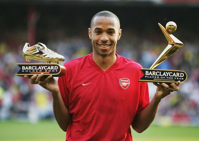 Thierry Henry of Arsenal shows off his Golden Boot and Barclaycard Premiership Player of the Year Award in 2004.