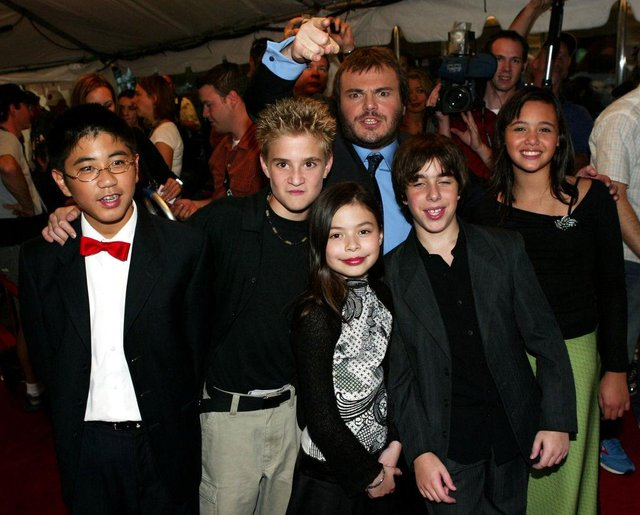 Jack Black (back) with the child cast members (L-R) Robert Tsei, Kevin Clark, Miranda Cosgrove, Joey Gaydos, and Rivkah Reyes attend the gala screening for 'School of Rock' during the 2003 Toronto International Film Festival (Photo: Donald Weber/Getty Images)