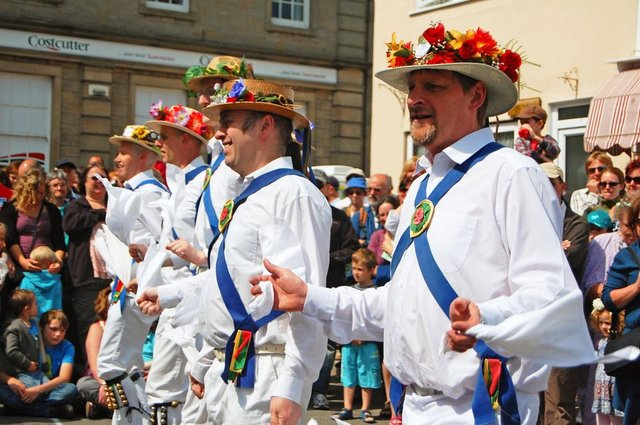 Morris dancers in the village square in Clun, Shropshire,  celebrating the May Day Bank Holiday.