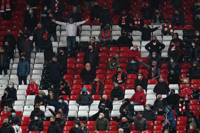 Fans react during the Premier League match between Liverpool and Tottenham Hotspur at Anfield in December. (Photo by Jon Super - Pool/Getty Images)