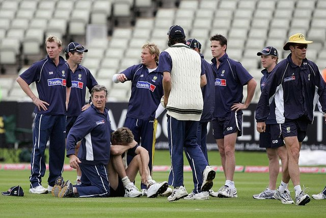 Glenn McGrath buries his head after hurting himself in training before day one of the second npower Ashes Test match between England and Australia at Edgbaston on August 4, 2005.