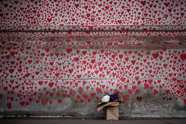 """Each heart on the memorial wall """"represents someone who was loved. Someone who was lost too soon to Covid-19"""", say the bereaved families group."""