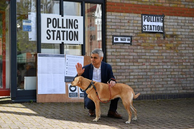 London Mayor Sadiq Khan waves to voters as he poses with his dog Luna on his arrival at a polling station in London (Justin Tallis / AFP) (Photo by JUSTIN TALLIS/AFP via Getty Images)