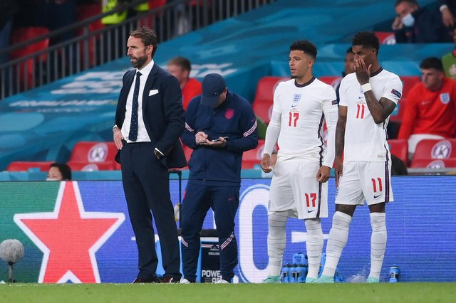 Jadon Sancho and Marcus Rashford of England wait to be substituted  (Photo by Laurence Griffiths/Getty Images)