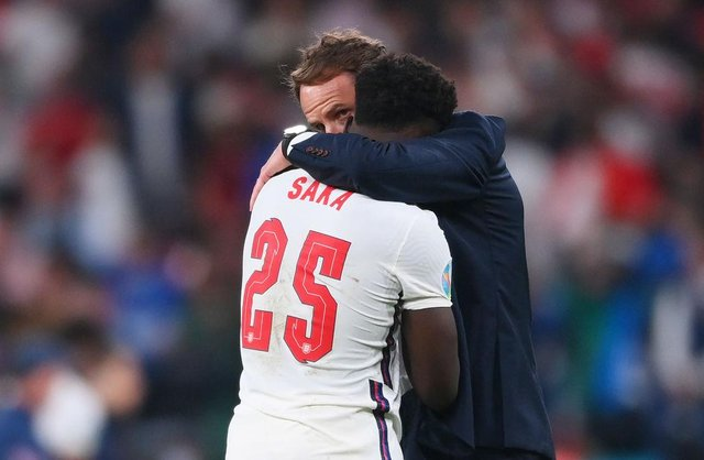 Bukayo Saka of England is consoled by Gareth Southgate, Head Coach of England, following defeat in the UEFA Euro 2020 Championship Final.