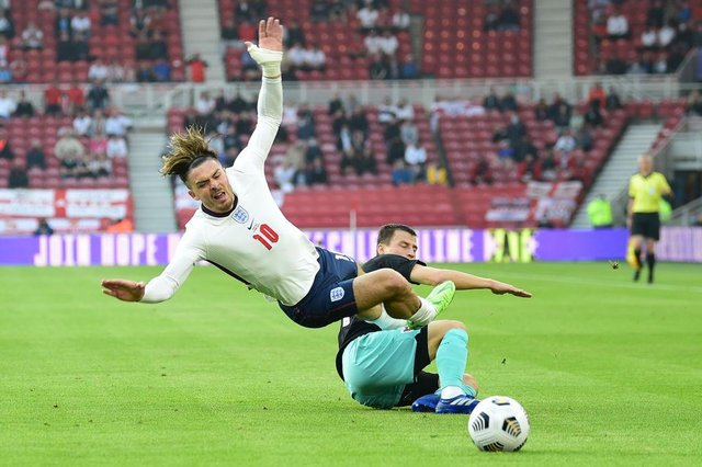 Jack Grealish is fouled by Stefan Lainer of Austria during the international friendly match at Riverside Stadium.