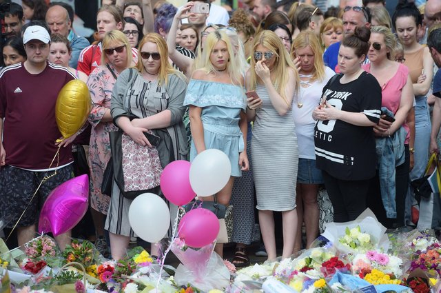 Floral tributes after a minute's silence in St Ann's Square, Manchester, to remember the victims of the terror attack in the city. A report examining security at Manchester Arena where 22 people were murdered and hundreds were injured in a suicide bombing at the end of an Ariana Grande concert in May 2017 was published today. (Photo: Ben Birchall, PA)