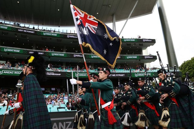 The Scots College Pipe band performs during an ANZAC Day ceremony ahead of the round seven NRL match between the Sydney Roosters and the St George Illawarra Dragons at the Sydney Cricket Ground, on April 25, 2021, in Sydney, Australia.