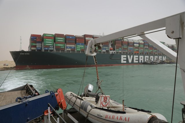 The Ever Given ran aground in the Suez Canal, Egypt, blocking the passage for scores of other ships (PA).