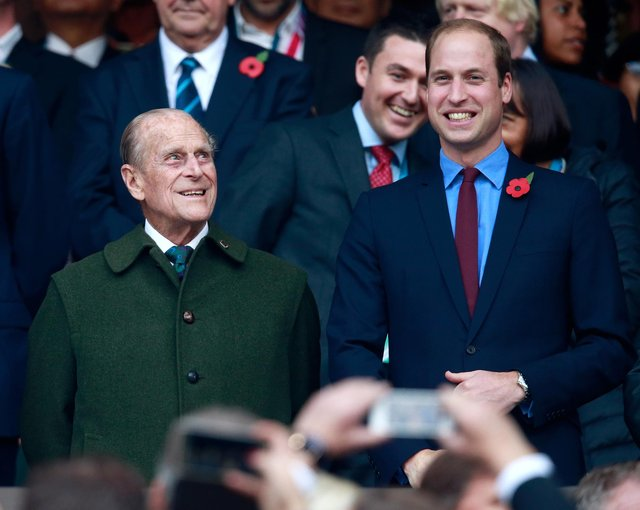Prince Phillip and Prince William enjoy the build up to the 2015 Rugby World Cup Final match between New Zealand and Australia at Twickenham Stadium (Photo by Phil Walter/Getty Images)