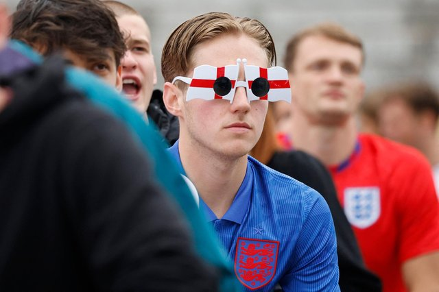 An England supporter wears St George's cross glasses while watching the UEFA Euro 2020 football match between England and Germany at the fan zone in central London (AFP/Getty Images)