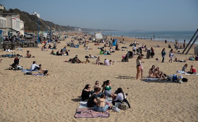 People enjoy the warm weather on Bournemouth beach in Dorset, as the UK has recorded its warmest March day in 53 years (Photo: Andrew Matthews/PA Wire/PA Images)