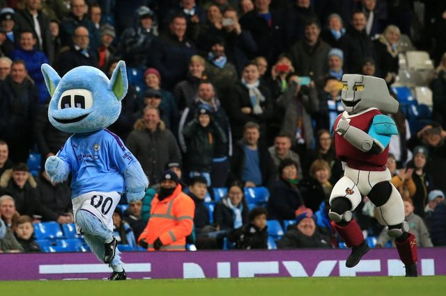 Man City mascot Moonchester beats West Ham mascot Hammerhead in a foot race.  (Photo by LINDSEY PARNABY/AFP via Getty Images)