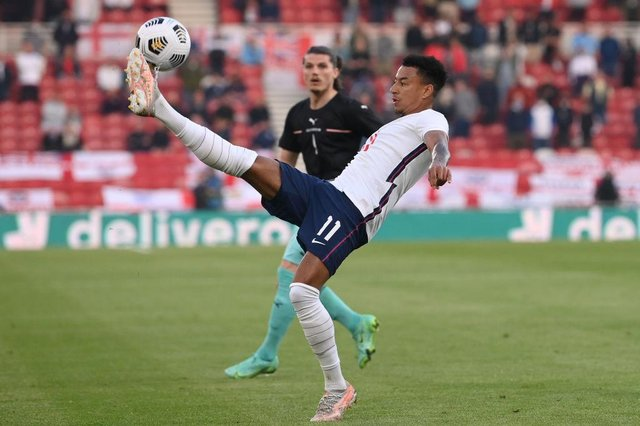 Jesse Lingard of England controls the ball during the international friendly match between England and Austria at Riverside Stadium.
