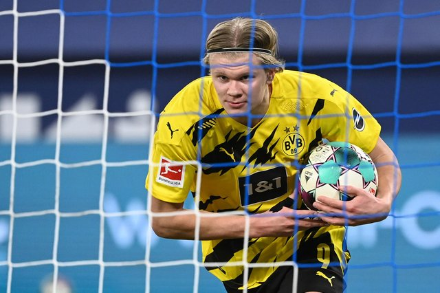 The bookies have their say on Chelsea, Man City, Liverpool and Man Utd's chances of landing Borussia Dortmund star Erling Haaland this summer. (Photo by INA FASSBENDER/AFP via Getty Images)