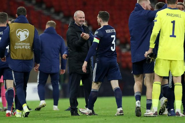 Steve Clarke shakes hands with captain Andy Robertson after his team's victory during the UEFA EURO 2020 play-off semi-final against Israel.