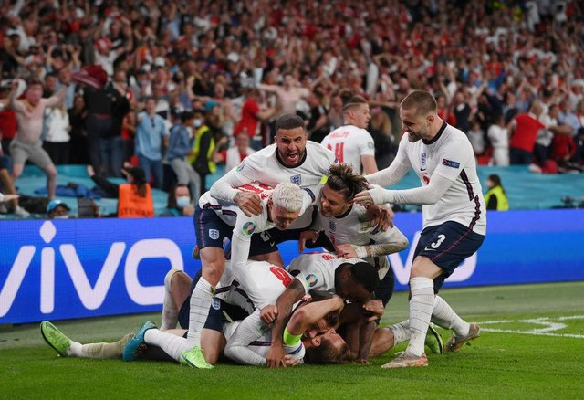 Harry Kane of England is congratulated after scoring his team's second goal by Jordan Henderson, Phil Foden, Kyle Walker, Jack Grealish, Raheem Sterling and Luke Shaw. (Photo by Laurence Griffiths/Getty Images)