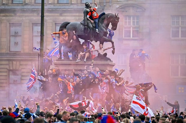 Rangers fans celebrate winning the Scottish Premiership title at George Square, Glasgow, on May 15, 2021.