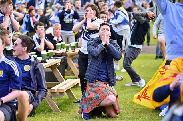 Scotland fans react as they watch their team crash out of Euro 2020 after defeat against Croatia.