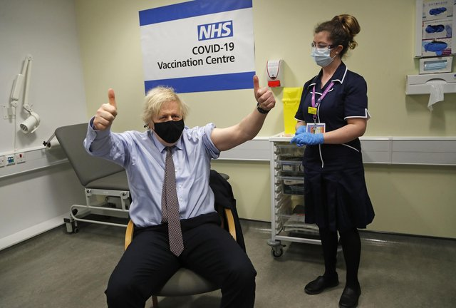 Prime Minister Boris Johnson gives thumbs up after receiving the first dose of AstraZeneca vaccine at Westminster Bridge Vaccination Centre in London (Photo: Frank Augstein/PA Wire/PA Images)