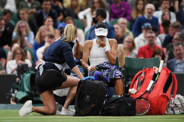 Following the conclusion of the third game of the second set of Emma Raducanu's fourth round match with Ajla Tomljanovic, the young Brit sought medical attention on court. (Pic: Getty)