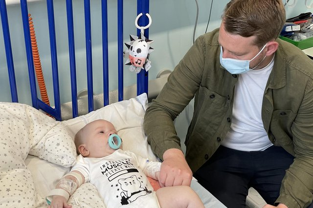 Five-month old Arthur Morgan, pictured in hospital with his dad Reece, has become the first patient in England treated with a potentially life-saving drug on the NHS that can prolong the lives of children with spinal muscular atrophy (image: PA).