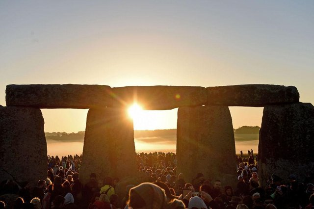 Many people also visit Stonehenge on the summer solstice to see the sun rise (Photo: Getty Images)