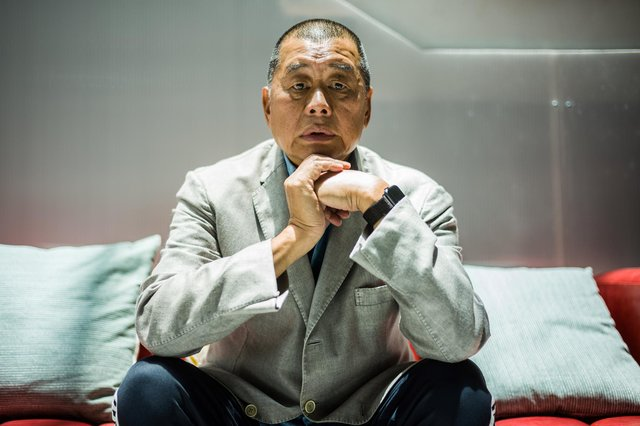 Millionaire media tycoon Jimmy Lai has been sentenced to 12 months in jail. (Photo by Anthony Wallace/AFP/Getty)