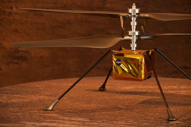 A full scale model of the experimental Ingenuity Mars Helicopter.