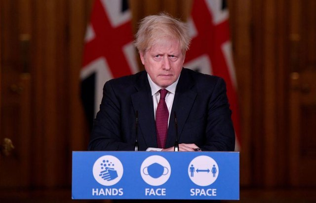 Boris Johnson used the catchy tagline to remind people of the importance of adhering to transmission-reducing tactics, but the phrase is out of touch with current government guidelines (Picture: Getty Images)