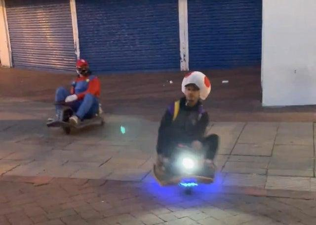 A still image of two of the fun-loving go-karters as they whizzed through Palmerston Road in Southsea. Picture: Daniel Balmbra