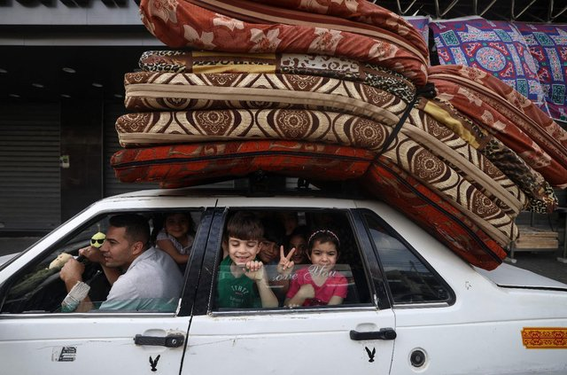 A Palestinian family returns to their house in Gaza City after a ceasefire was agreed between Israel and Hamas. (Pic: Getty)