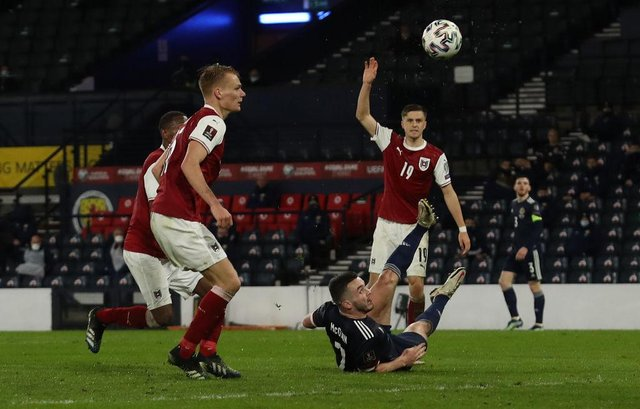 ohn McGinn's superb overhead kick rescued a point for Scotland in the 85th minute of their opening World Cup qualifier against Austria