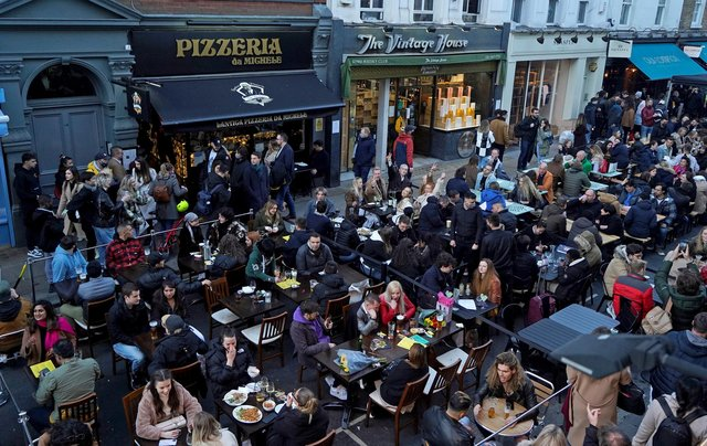 Diners eat in the streets of Soho on April 16 following step two of the government's roadmap out of England's lockdown (Niklas Halle'n/AFP via Getty)
