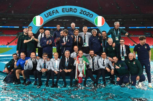 Roberto Mancini and the backroom staff celebrate with The Henri Delaunay Trophy following his team's victory in the UEFA Euro 2020 Championship Final between Italy and England at Wembley Stadium (Picture: Getty Images)
