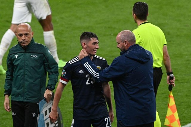 Scotland's midfielder Billy Gilmour and coach Steve Clarke hug after the England game on Friday night.