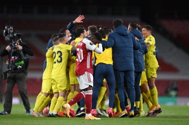 Eddie Nketiah of Arsenal looks dejected as the Villareal CF team celebrate victory following the UEFA Europa League semi-final second leg match