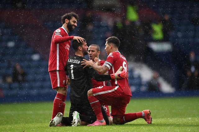 Alisson Becker of Liverpool is congratulated on scoring the winning goal by Mohamed Salah, Thiago Alcantara and Roberto Firmino during the Premier League match between West Bromwich Albion and Liverpool at The Hawthorns.